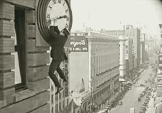 """Harold LLoyd      """"During the famous clock tower stunt, Harold Lloyd is not as far from the ground as he appears. The building on which he climbs was actually a fake wall constructed on the roof of an actual skyscraper and skillfully photographed to maintain the illusion.""""   .......1923"""