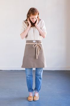"""The No. 306 is a light but sturdy twill bistro apron with a comfortable hand and drape. Made to be used in kitchens, restaurants and bakeries, where regular laundering is necessary. Need 12+ aprons? Contact us for wholesale pricing! Sizing 20"""" long x 29.5"""" wide 38"""" cotton tapes Features Solid brass grommets Preshrunk material for easier laundering Colorway Clay Khaki cotton apron tapes Materials 8.5oz preshrunk brushed twill Solid brass grommets Heavy cotton..."""