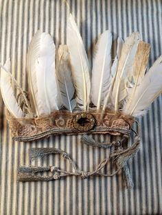 Handmade feathered bridal headpieces  made from vintage, treasured finds~Image by Emma Freemantle