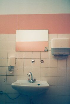 'Look in a public space' Something as simple as a public bathroom but the colour of the wall and the white tiles make it look retro.