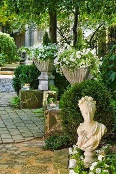 white petunias in garden urns