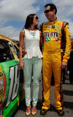 Love the mint skinny jeans. (Samantha and Kyle Busch during pre-race ceremonies for the NASCAR Sprint Cup Series Quicken Loans 400 at Michigan International Speedway on June 16, 2013)