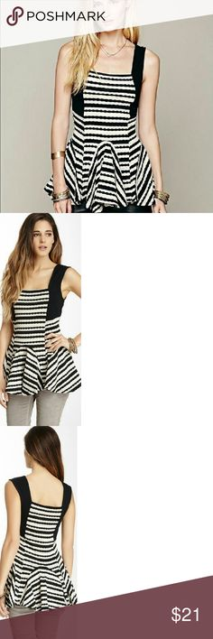 """Free People Sedwick Jacquard Striped Peplum Tank Excellent Condition Free People top worn only one time  Size: Medium Color: Black Combo Details- Square neck - Sleeveless with contrast solid straps - Peplum waist detail - Allover jacquard stripe print - Approx. 26"""" length - Imported  Fiber Content  Body: 68% polyester, 32% cotton Trim: 95% cotton, 5% spandex Care. Machine wash Additional Info.  Fit: this style fits true to size per website but I felt it has a little more room....so could fit…"""