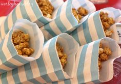 Bags of popcorn as a #partyfavor - and we are loving the striped bags from @The TomKat Studio!