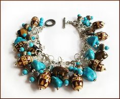 Vivid Sky Blue Turquoise Beads and Nuggets, Tiger Eye Zuni Bears and Southwestern Design Ceramic Beads Make Up This Pretty Brown and Turquoise Sterling Fashion Bracelet. The Bracelet is Sterling; the Jewelry Findings are Silver-tone Metal. Easy On/Off Sterling Rope Design Toggle Clasp.  Fits Size 7 to 7-3/4 Wrist.  Total Weight: 68gms.  Chocolate Browns and Turquoise Zuni Bear Sterling Charm Bracelet  Enter my store: http://www.etsy.com/shop/SouthwestSkyJewelry  See All My Bracelets…