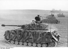 Panzer IV camouflaged with armor skirts, on exercise northern france 1943