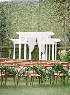 Simple Green Garland | #Ceremony Decor | See the wedding on #SMP:  http://www.stylemepretty.com/2013/12/12/traditional-charleston-wedding/ KT Merry Photography