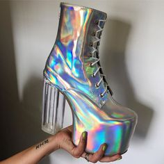 space boots I think the actual boot shape is ugly but I totally just bought  a pair of Steve Madden holographic heels and I love them!