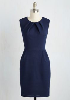 Poised before the crowd, you accept your award in this navy blue dress. Your scientific advances are matched only by your fashionable ones, which is why you credit the ruched neckline, pockets, and eyelet overlay of this polished sheath as the inspiration for your stylish achievement.