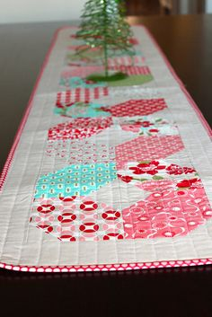could do w/layer cake for a quick quilt New table runner by kelbysews, via Flickr
