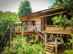See a traditional Thai-style wooden house surrounded by high floors. With a natural atmosphere, with a terrace, a terrace, a relaxing corner that can be seen all around Bamboo House Design, Wooden House Design, Timber Architecture, Sustainable Architecture, Architecture Design, Hut House, Jungle House, Bungalow, Tropical Houses