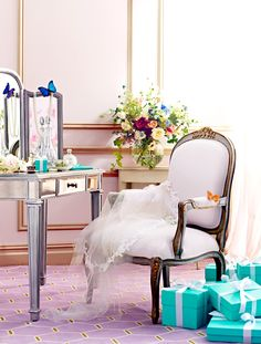 tiffanyandco Brighten up a bridal dressing area with elegant floral arrangements. Then take a moment to smell the roses.   Find more ideas for a celebration to remember on Tiffany Weddings.