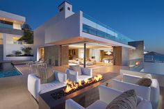 Ocean home with detached guest house on top of a vertical and rocky site overlooking the Pacific Ocean in Laguna Beach, California, by Horst Architects