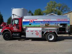 Red Star Oil tanker truck partial wrap with reflective vinyl lettering and logo