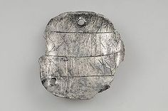 Silver rune pendant found at Birka. In the Historiska Museet, Stockholm.