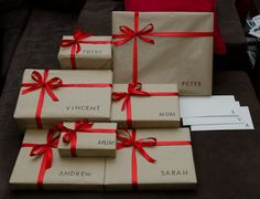 DIY Christmas Wrapping Idea.... Cut Out Or Stamp Names For Gift Wrap.... Tie With Coordinating Ribbon....
