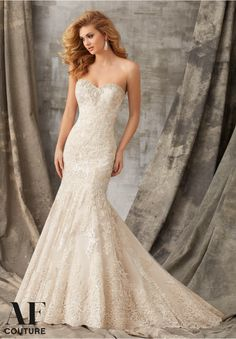 Bridal Gowns By AF Couture featuring Tonal Embroidery Combined with Venice Lace Appliques on Tulle Trimmed with Crystal Beading Available in Three Lengths: 55', 58', 61'. Colors Available: White/Silver, Ivory/Silver, Caramel/Silver