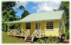 Like a little yellow plantation cottage. I love it, especially the detailing on the porch rails.