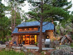 Tiny cottage, Colorado cottage, stone cottage, remodel, patio, outdoor grill, built in grill ARCHITECTURE & INTERIOR DESIGN by TKP Architects PHOTO by Emily Minton Redfield MORE INFO at:  http://www.mountainliving.com/article/450-square-foot-cottage#