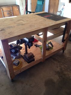 My new rolling work bench with built in table saw.