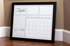 Custom printable family calendar put into a large frame (the glass works to make it like a whiteboard) $12.00, via Etsy. - Maybe do something like this for the calendar?