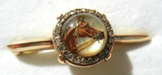 Vintage gold intaglio horse crystal and diamond pin/brooch | eBay http://www.ebay.com/itm/Vintage-gold-intaglio-horse-crystal-and-diamond-pin-brooch-/221014015919?pt=LH_DefaultDomain_0&hash=item3375763faf