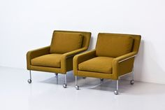 Easy chairs by DUX
