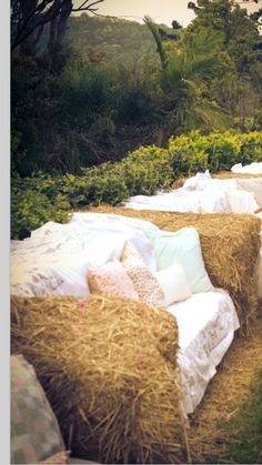 Hay bale seats, very cool and cheap idea! Would be lovely in an outdoor wedding, even have it as a cute photo booth :)