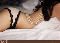 Play with a strand of pearls. | 33 Impossibly Sexy Boudoir Photo Poses