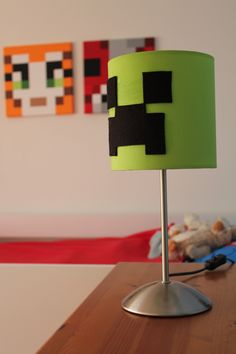 Minecraft Creeper Lamp.  Some black felt, lovely lime green lamp (another ikea special!) and a bit of inspiration and we have our very own 'Creeper lamp' to add the finishing touches :)