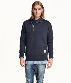 An example of POOR FIT- the torso is completely swallowed and tubular.  Sweater shouldn't be tight but needs shape from armpit to waist.  Product Detail | H&M US