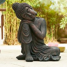 £58 Serene bronze resin buddha sculpture in resting pose, suitable for outdoor use.
