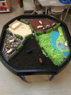 My tuff spot small world farm. Black tray put to good use for our farm topic :) continuous provision.