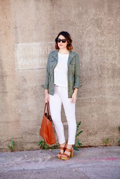white embroidered blouse + white denim + olive-green anorak + cognac leather