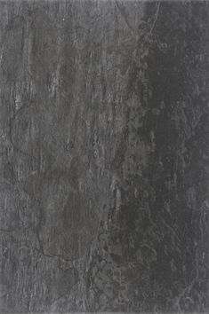 The Alda Antracite tile is a 40x60cm, black colour, slate effect glazed porcelain floor tile with a textured riven satin finish. Ideal as a kitchen or living room floor tile. HD digital inkjet print technology means this porcelain tile looks just like natural slate with a random print effect