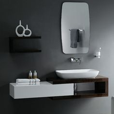 "Cabinet measures (Including sink): 18 5/8"" H x 64 1/2"" W x 18 1/2"" D Includes one mirror Mirror Dimension: 35 9/16"" H x 21 1/8"" W x 1/8"""