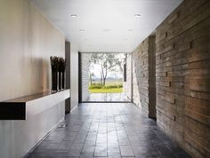 exterior charming kohout residence home design interior in hallway decorated with stone wall decor and concrete tilestile