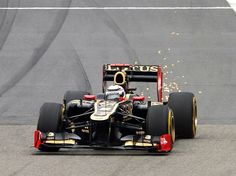 F1 Chinese GP - Sparks fly from the rear of Kimi Raikkonen's Lotus