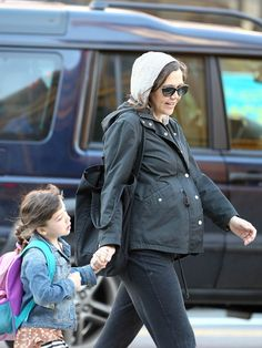 Maggie Gyllenhaal shows off her baby bump as she walks her daughter Ramona to school on March 14, 2012