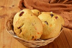A basket of cranberry orange cookies on a rustic wooden table
