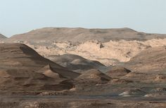 This composite image looking toward the higher regions of Mount Sharp was taken on Sept. 9, 2015, by NASA's Curiosity rover. In the foreground -- about 2 miles (3 kilometers) from the rover -- is a long ridge teeming with hematite, an iron oxide. NASA/JPL-CALTECH