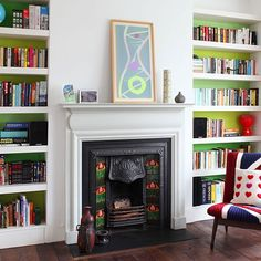 Green and white living room with fireplace | Living room decorating