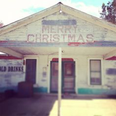 the MERRY CHRISTMAS bar in Round Top Texas