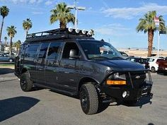 Chevy Express van with Aluminess bumpers, ladder and roof rack. Chevrolet Van, Chevy Van, 4x4 Camper Van, 4x4 Van, Chevy Express, Sportsmobile Van, Ambulance, Lifted Van, Gmc Vans