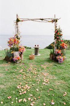 birch arch with bright flowers - Ultrapom Event Rental #WeddingCeremony