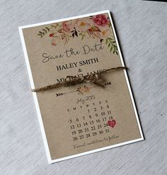 Circle the date for them with this Kraft paper calendar save the date. Great for vintage-rustic weddings with lots of burlap and lace, this save the date is decorated with flowers and tied up in twine.