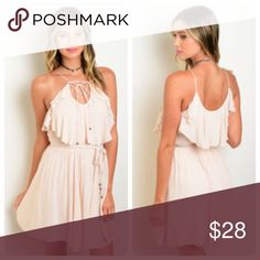 Blush Sun Dress This flouncy woven dress features a ruffle front bodice, a self-tie neckline as well as a self-tie waist sash. Full lined and empire silhouette fit. It is made of 100% rayon. Available in small, medium, and large. Dresses