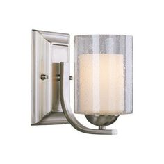 "Cosmo 1 Light Bath Vanity Light Finish: Satin Nickel by Woodbridge Lighting. $75.00. 53111-STN Finish: Satin Nickel Features: -Bath vanity light. -Cosmo collection. -Number of light: 1. -Inner opal glass and clear seedy outer. -UL listed for damp locations. Specifications: -Bulb type: 100W medium base bulb. -Overall dimensions: 8"" H x 5"" W x 8.25"" D."