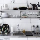 An interesting trend creeping into kitchen design lately is home kitchens that look a lot like commercial kitchens. Even if you're not ready to embrace the full-on restaurant look, you can inject a little bit of that industrial feel into your own space with stainless steel countertops.