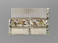 Woman's Comb;  Date: 15th or 16th century;  Culture: French or Italian;  Medium: Ivory, paint and gilding;  Dimensions: Overall: 3 7/16 x 5 1/16 x 3/16 in. (8.8 x 12.9 x 0.4 cm);  Accession Number: 17.190.245